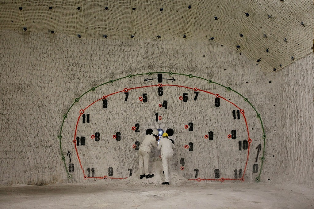LW_Employees-pose-in-a-cavern-with-test-drills-in-a-pilot-mine-which-is-being-tested-for-potential-use-as-a-permanent-nuclear-waste-storage-facility-at-the-salt-dome-near-the-northern-German-village-of-Gorleben-on-July-2-2010.-Th